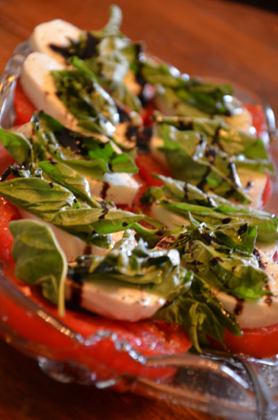 Tomato, mozzarella, basil salad photo by Glen Green